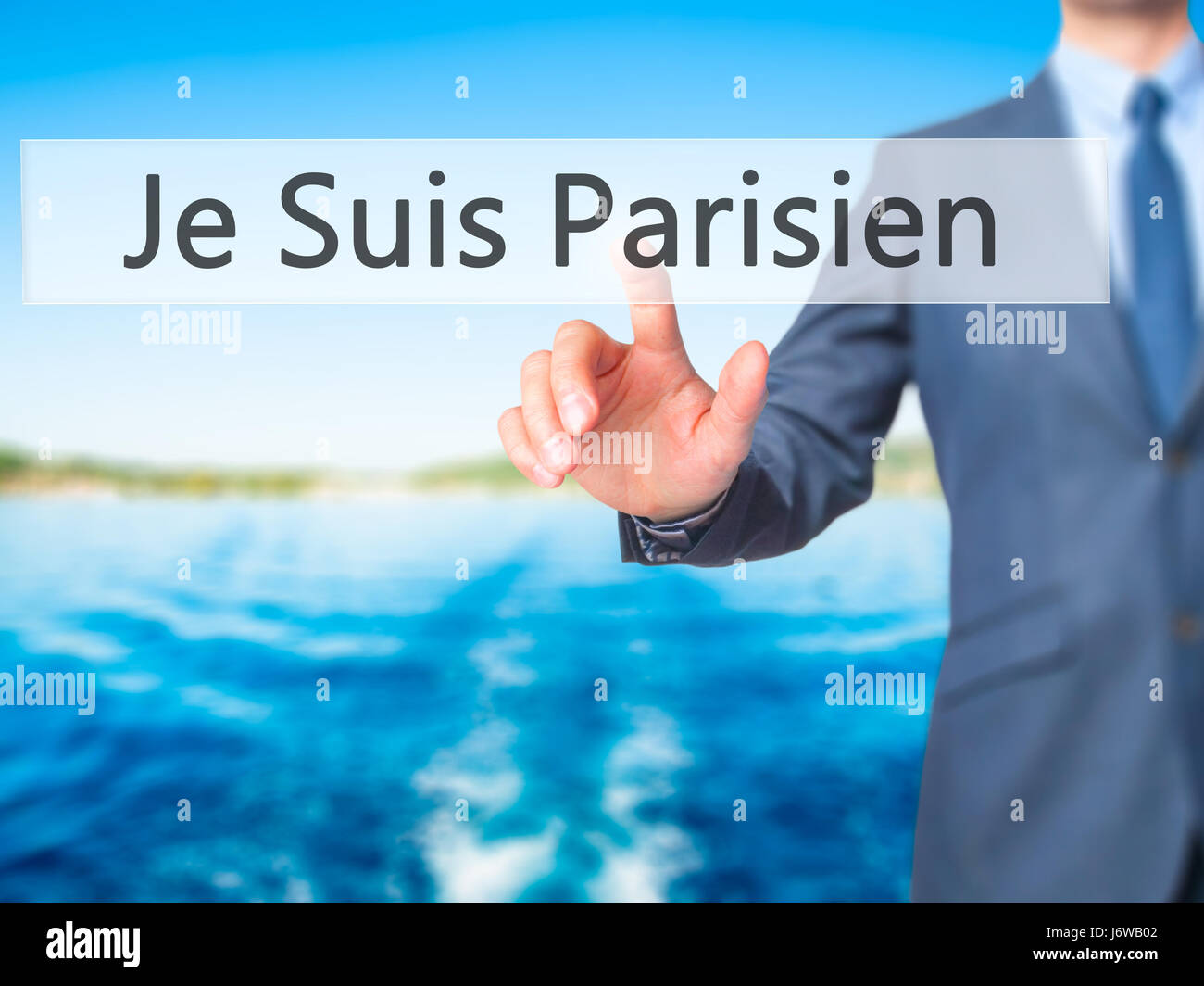 Je Suis Parisien ( I am Parisien)  - Businessman hand pressing button on touch screen interface. Business, technology, Stock Photo