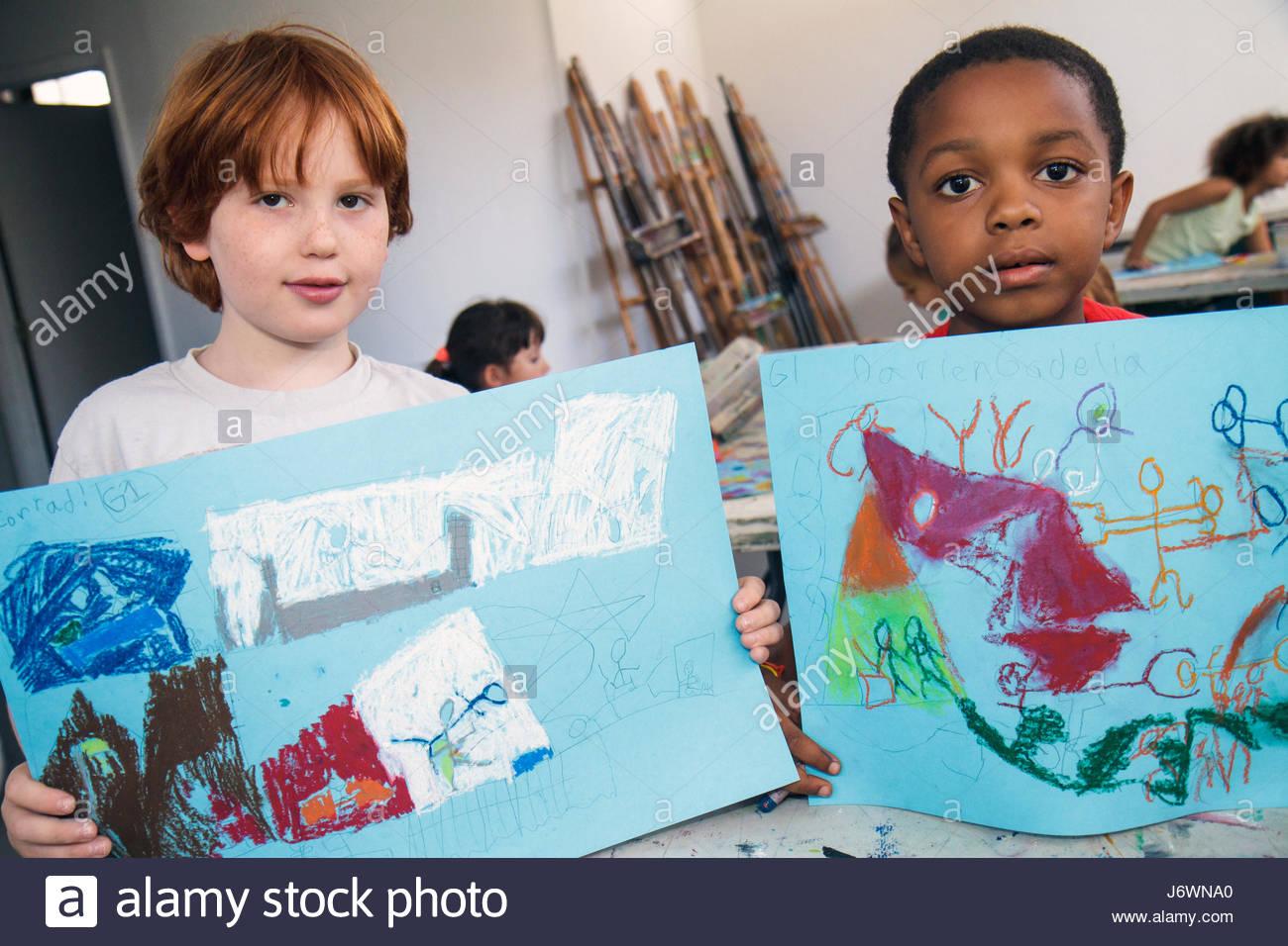Miami Beach Florida ArtCenter South Florida Art Camp class Black boy chalk drawing - Stock Image