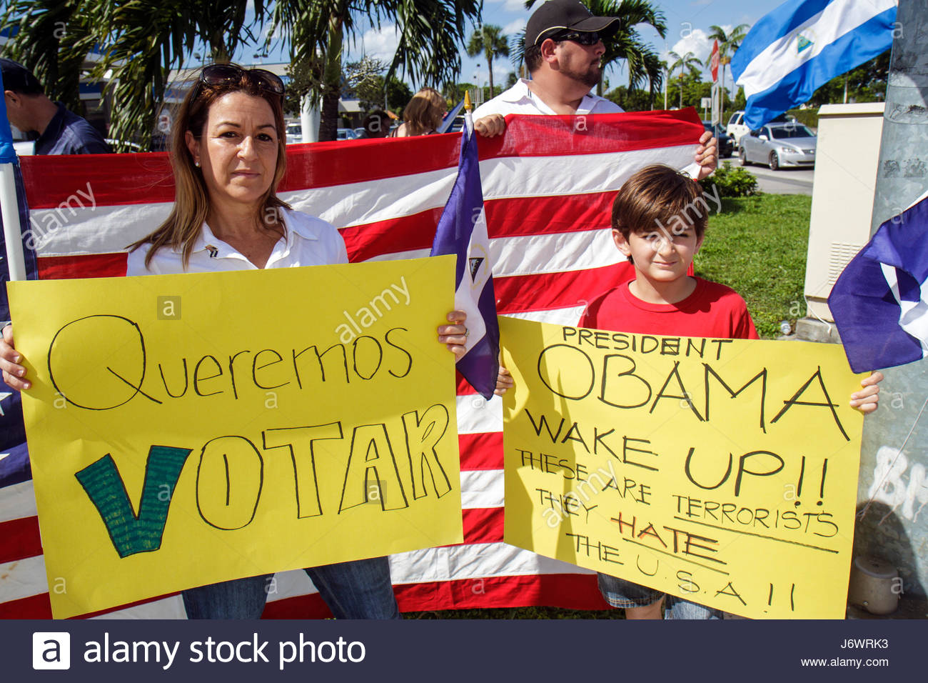 Miami Florida protest Hispanic protesting street named after corrupt Nicaraguan general flag protesters student - Stock Image