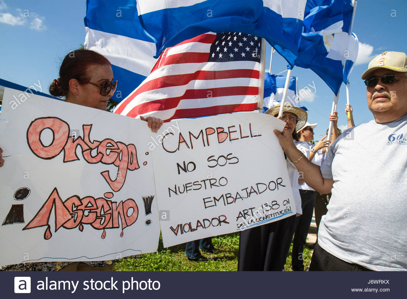 Miami Florida protest Hispanic protesting street named after corrupt Nicaraguan general flag protesters woman man - Stock Image