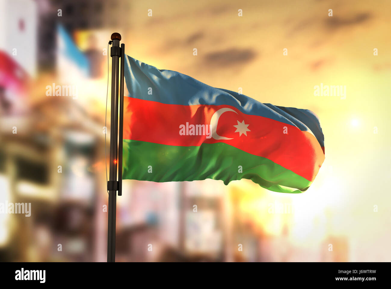 Azerbaijan Flag Against City Blurred Background At Sunrise Backlight - Stock Image
