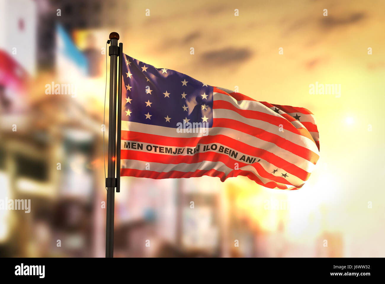 Bikini Atoll Flag Against City Blurred Background At Sunrise Backlight - Stock Image