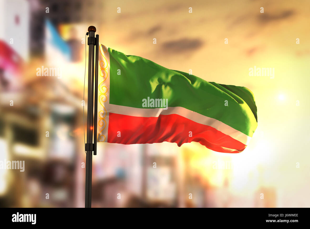 Chechen Republic Flag Against City Blurred Background At Sunrise Backlight - Stock Image