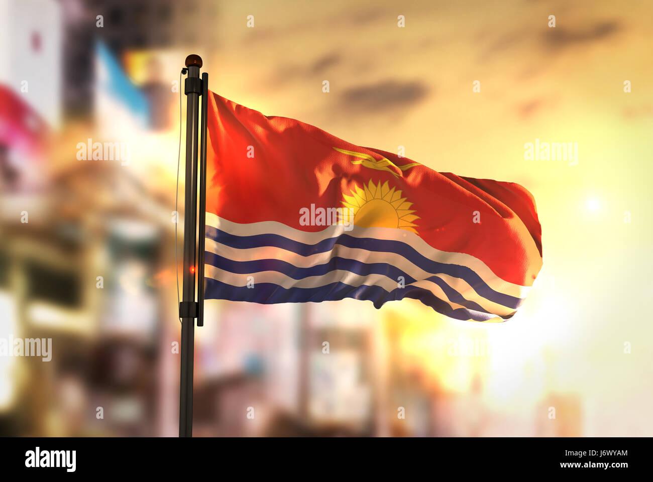 Kiribati Flag Against City Blurred Background At Sunrise Backlight - Stock Image