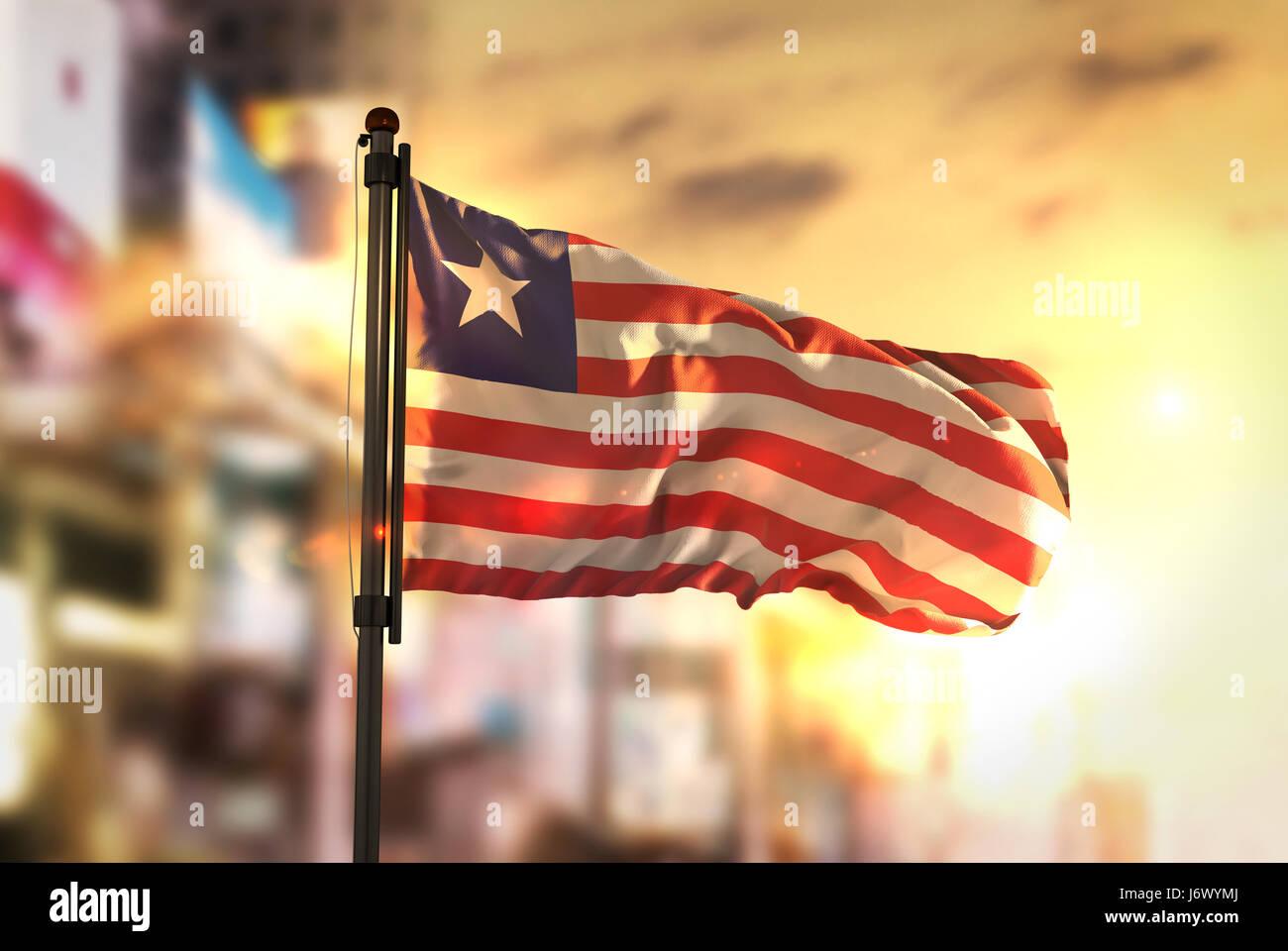 Liberia Flag Against City Blurred Background At Sunrise Backlight - Stock Image