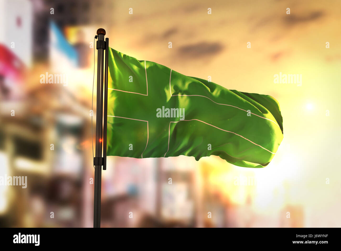 Ladonia Flag Against City Blurred Background At Sunrise Backlight Stock Photo