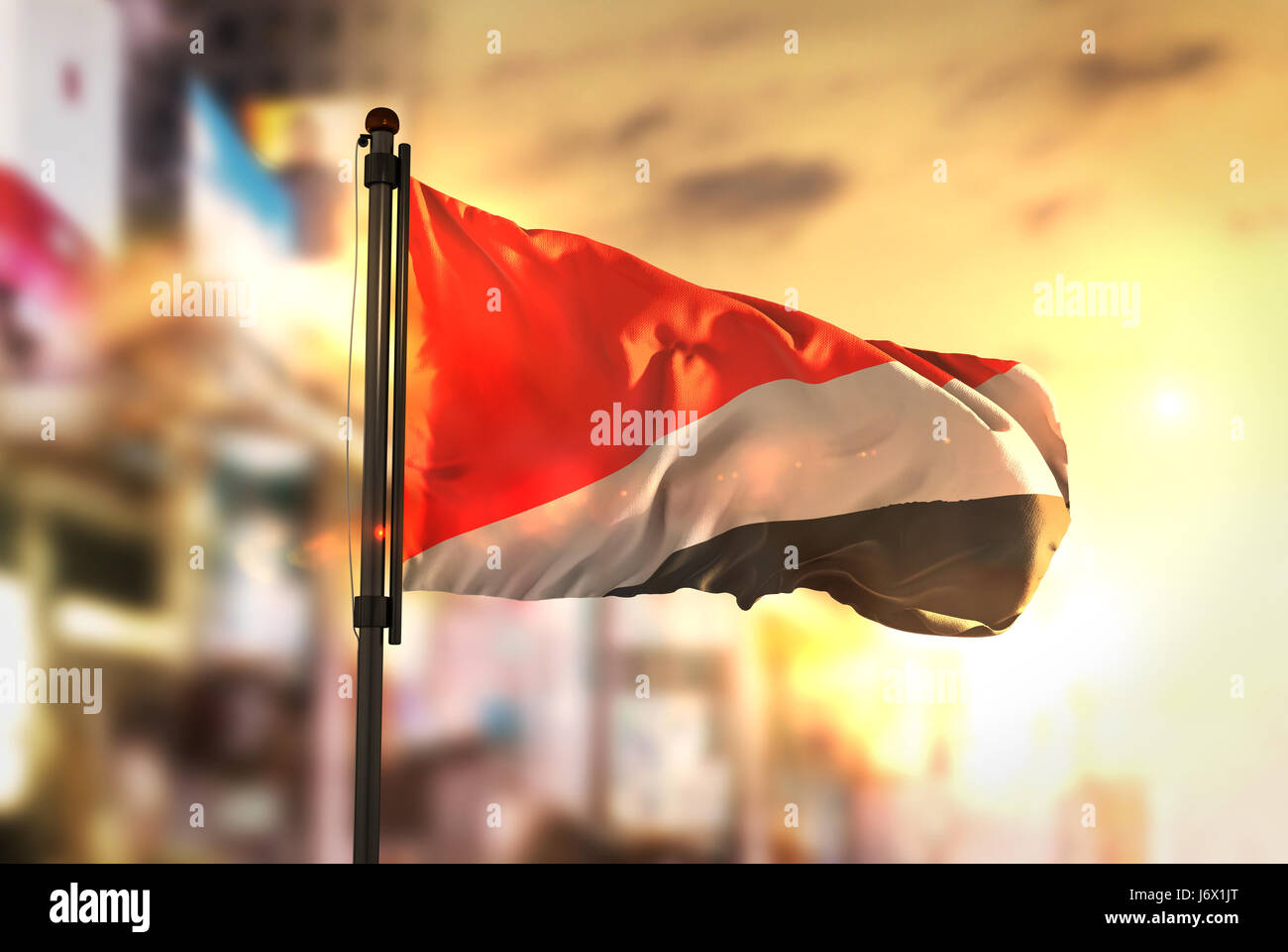 Principality of Sealand Flag Against City Blurred Background At Sunrise Backlight - Stock Image