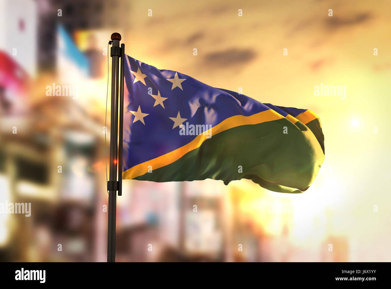 Solomon Islands Flag Against City Blurred Background At Sunrise Backlight - Stock Image