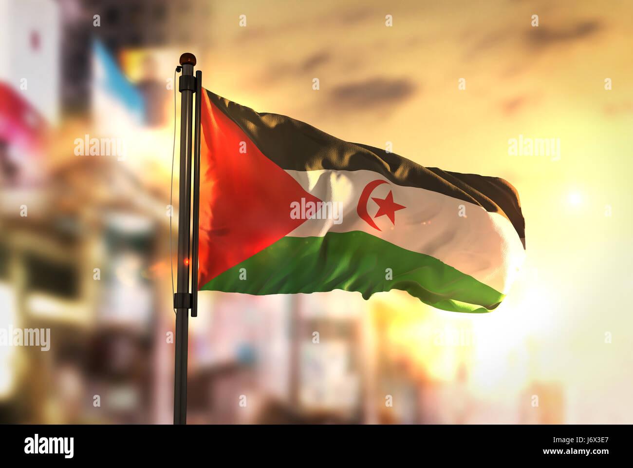 Sahrawi Flag Against City Blurred Background At Sunrise Backlight - Stock Image