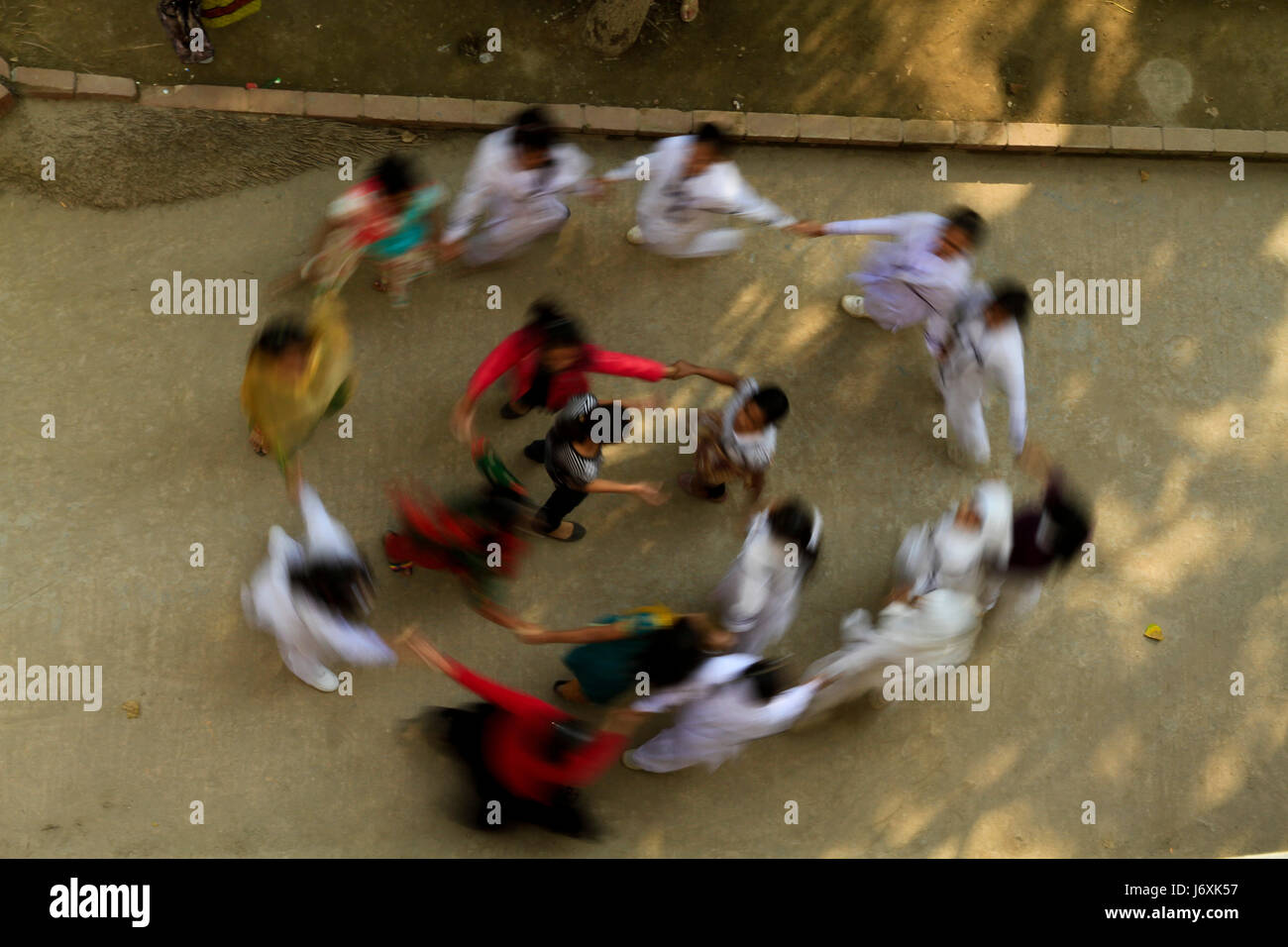 Jubilant students of Monipur School after publication of Primary Terminal Examinations (PTE) results. Dhaka, Bangladesh - Stock Image