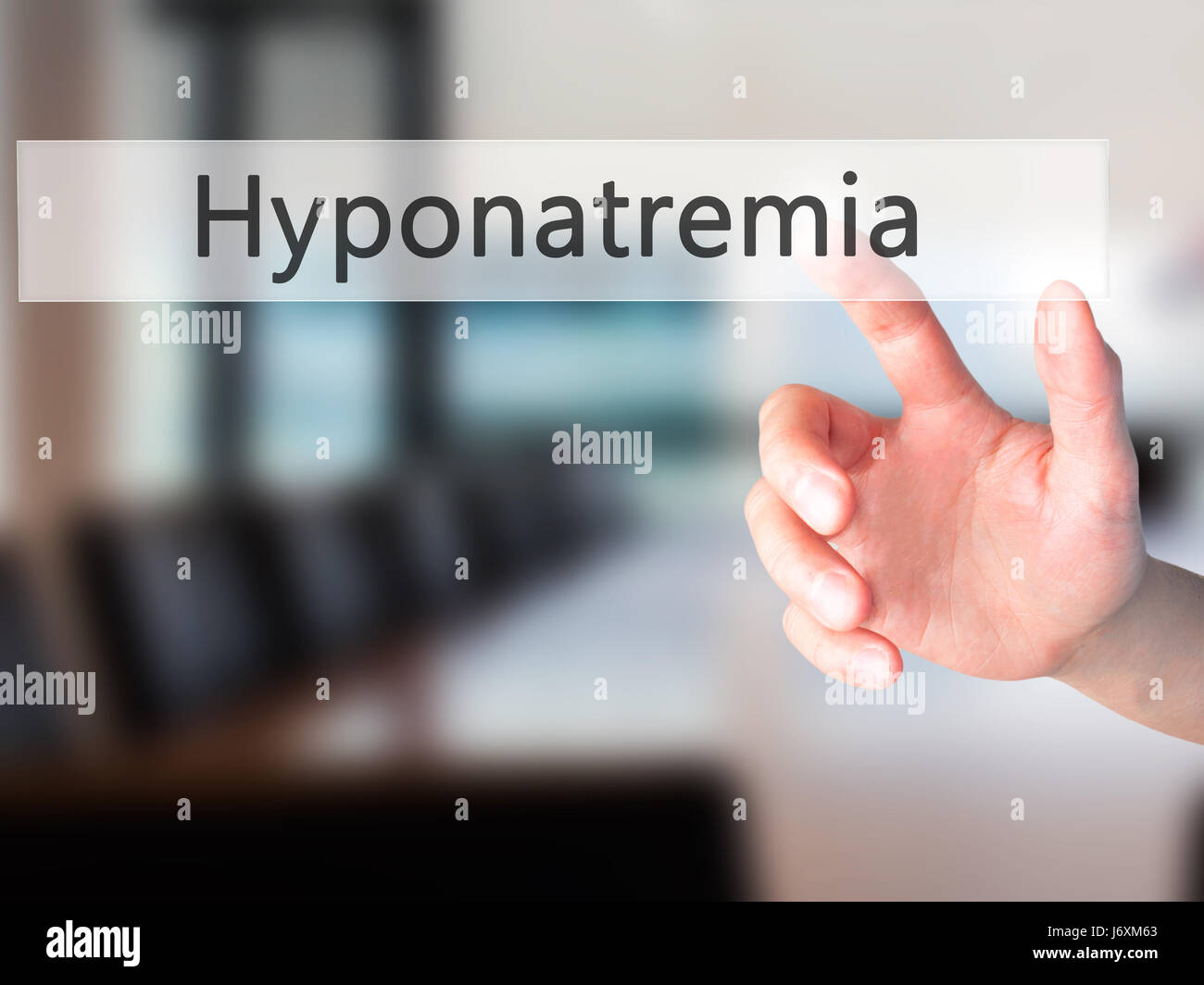 Hyponatremia - Hand pressing a button on blurred background concept . Business, technology, internet concept. Stock - Stock Image