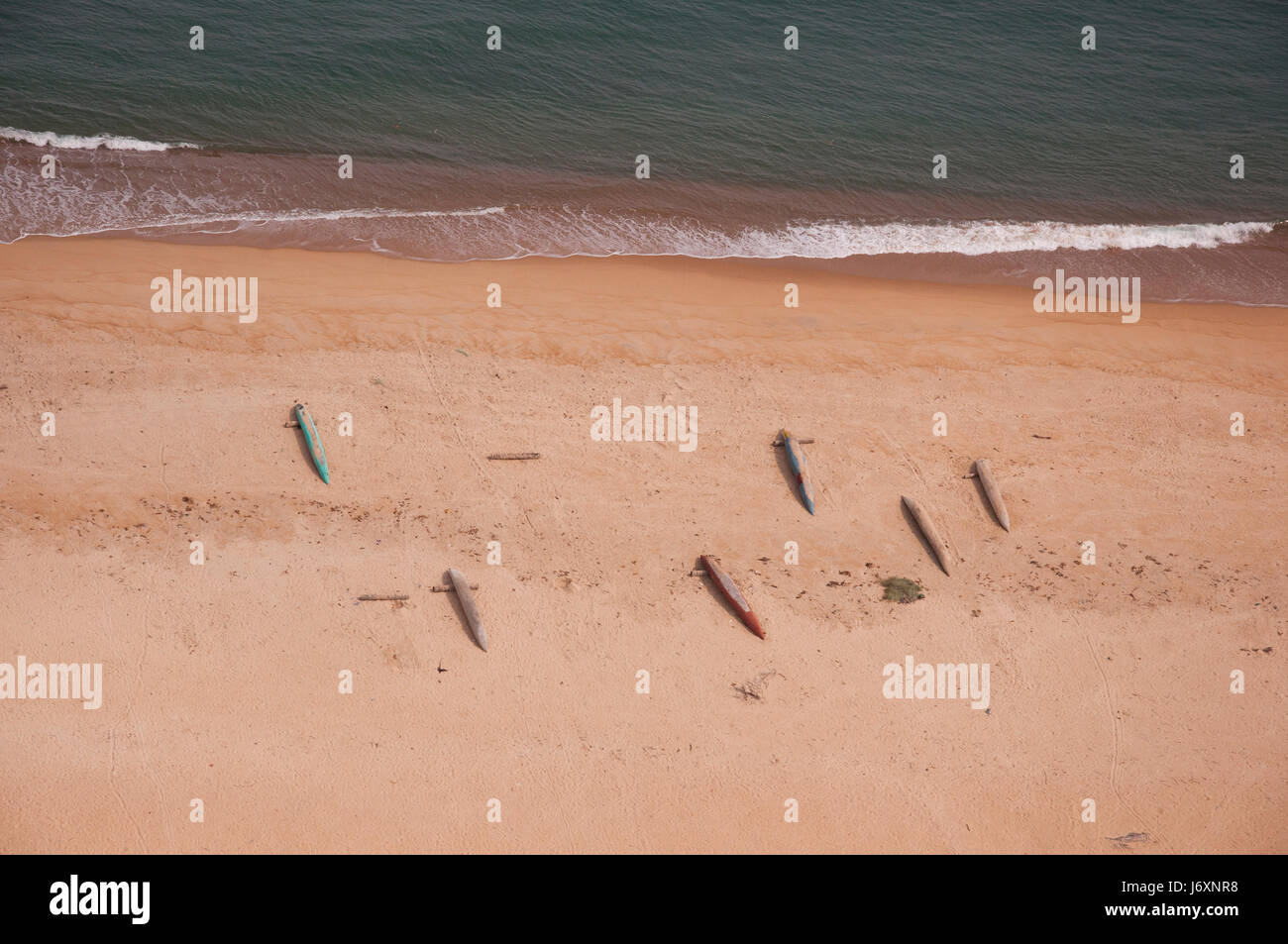 Aerial photograph of canoes, dugouts and fishing nets, midday, on a ferry flight from Monrovia to Freetown. - Stock Image