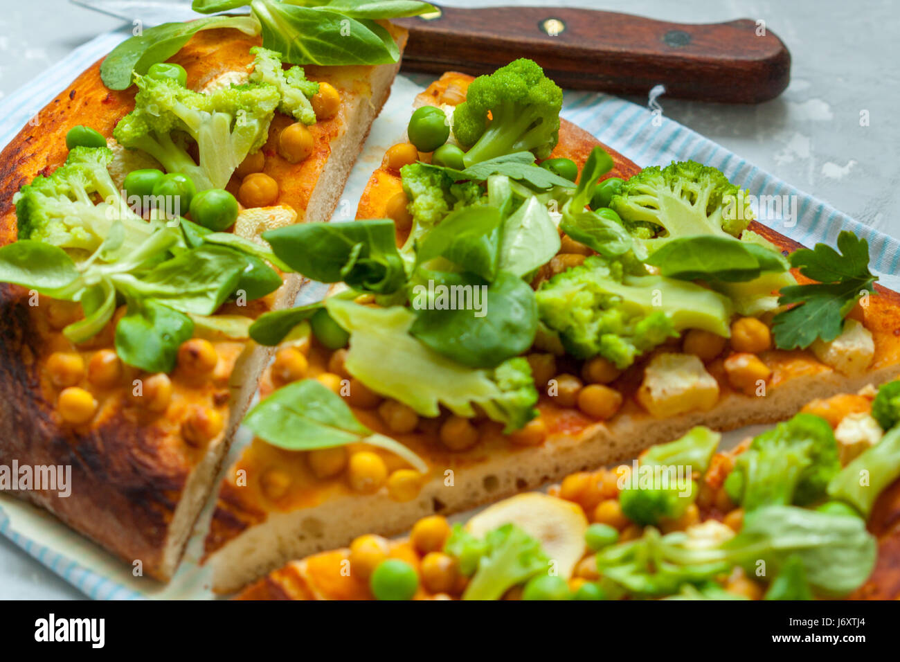 Vegan pizza with chickpeas and broccoli. Love for a healthy vegan food concept - Stock Image