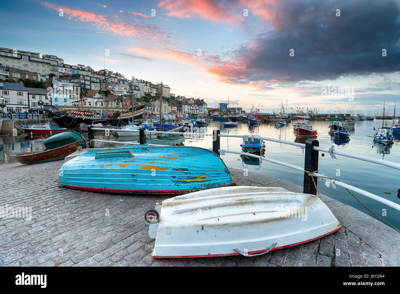 Sunset over the harbour at Brixham on the south coast of Devon - Stock Image
