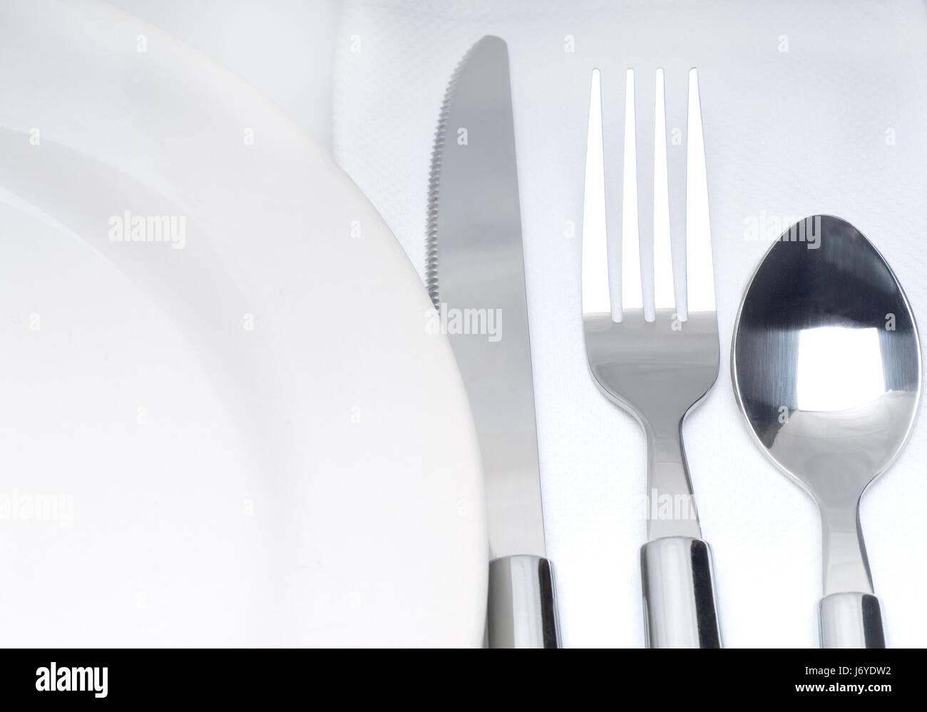 plate seat fork napkin white arm weapon knive knife spoon restaurant bar tavern - Stock Image
