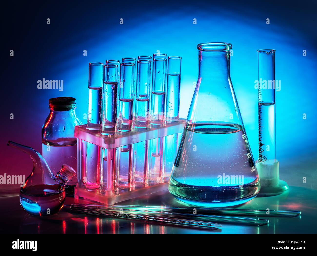 Different laboratory beakers and glassware. Multicolored. Stock Photo