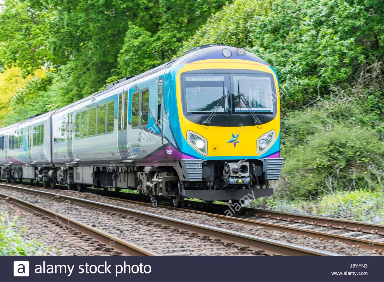 A Transpennine express train at Grange over Sands heads for Lancaster - Stock Image