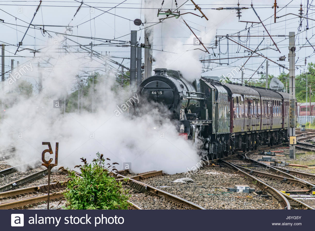 The Scots Guardsman steam locomotive crosses the junction to join the main west coast line to head for Carlisle. - Stock Image