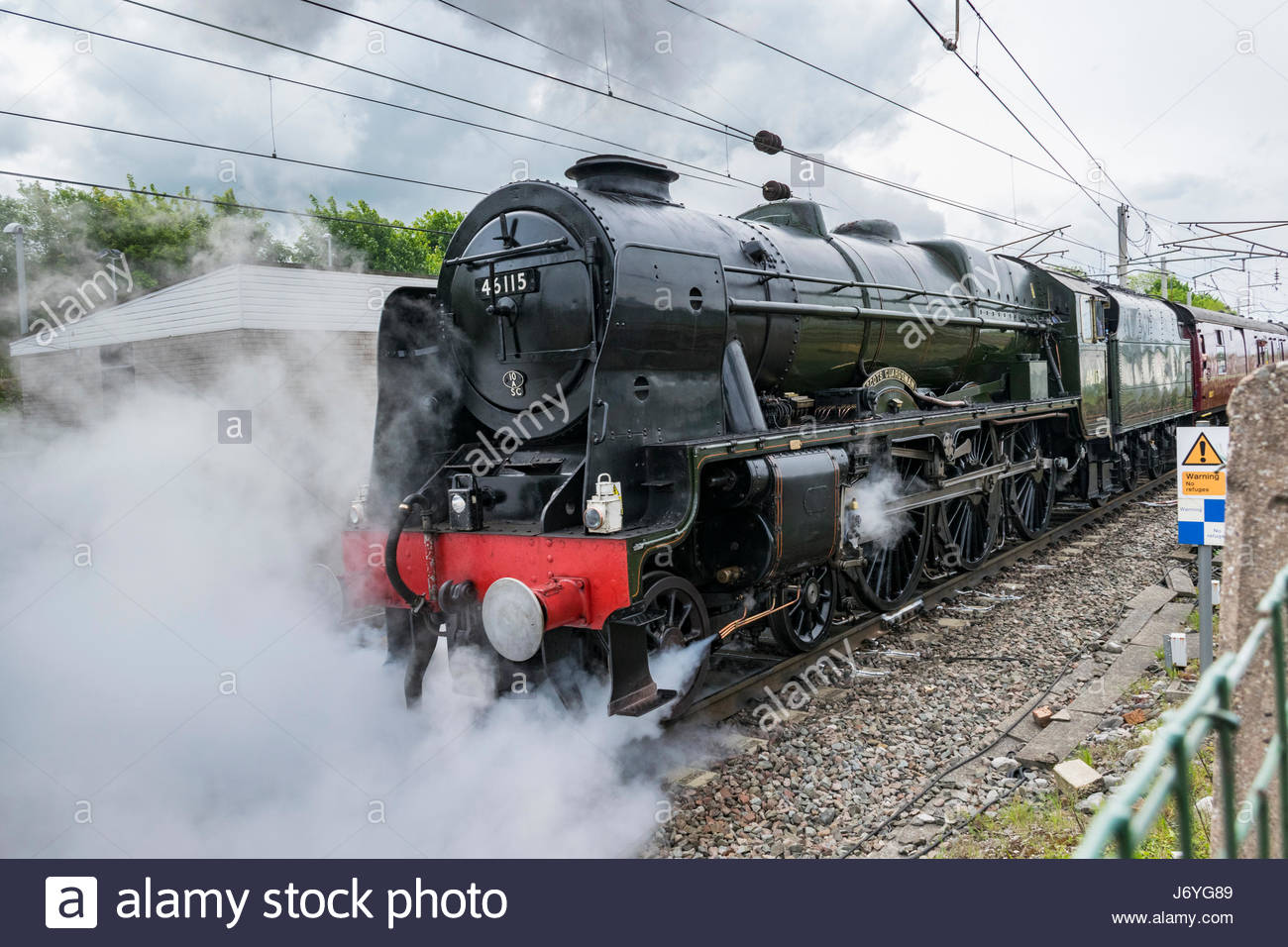 The Scots Guardsman steam locomotive heads for Carlisle on the main West Coast line. - Stock Image