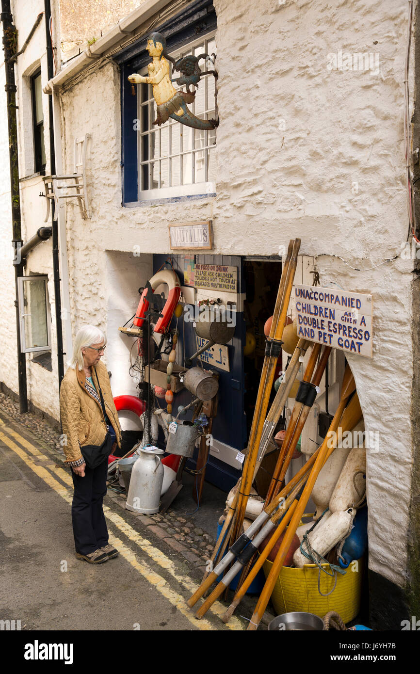 UK, Cornwall, Mevagissey, Middle Wharf, visitor outside Nautilus maritime memorabilia antiques shop - Stock Image