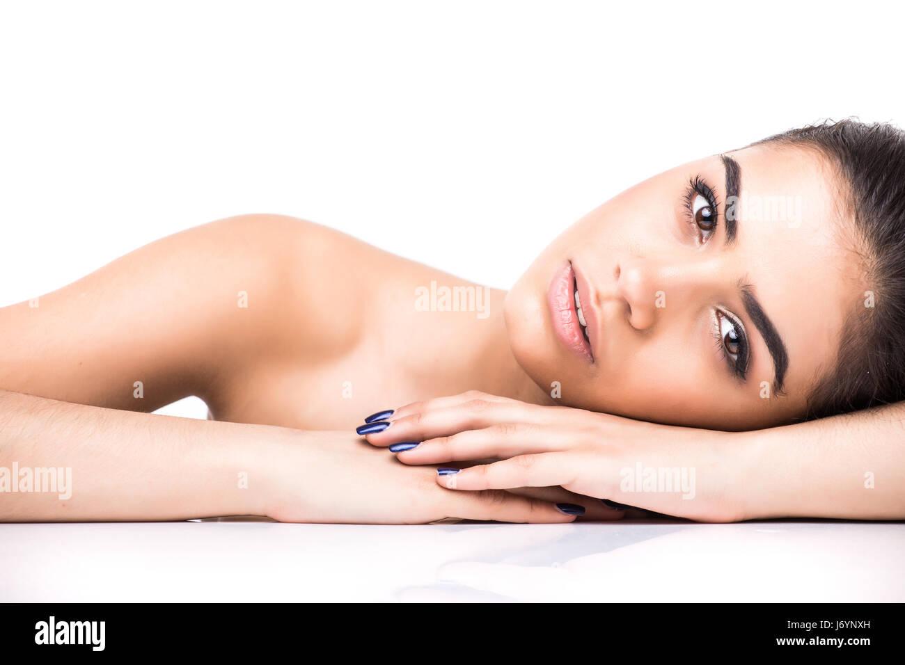 beautiful young smiling latina lying on the white background. - Stock Image