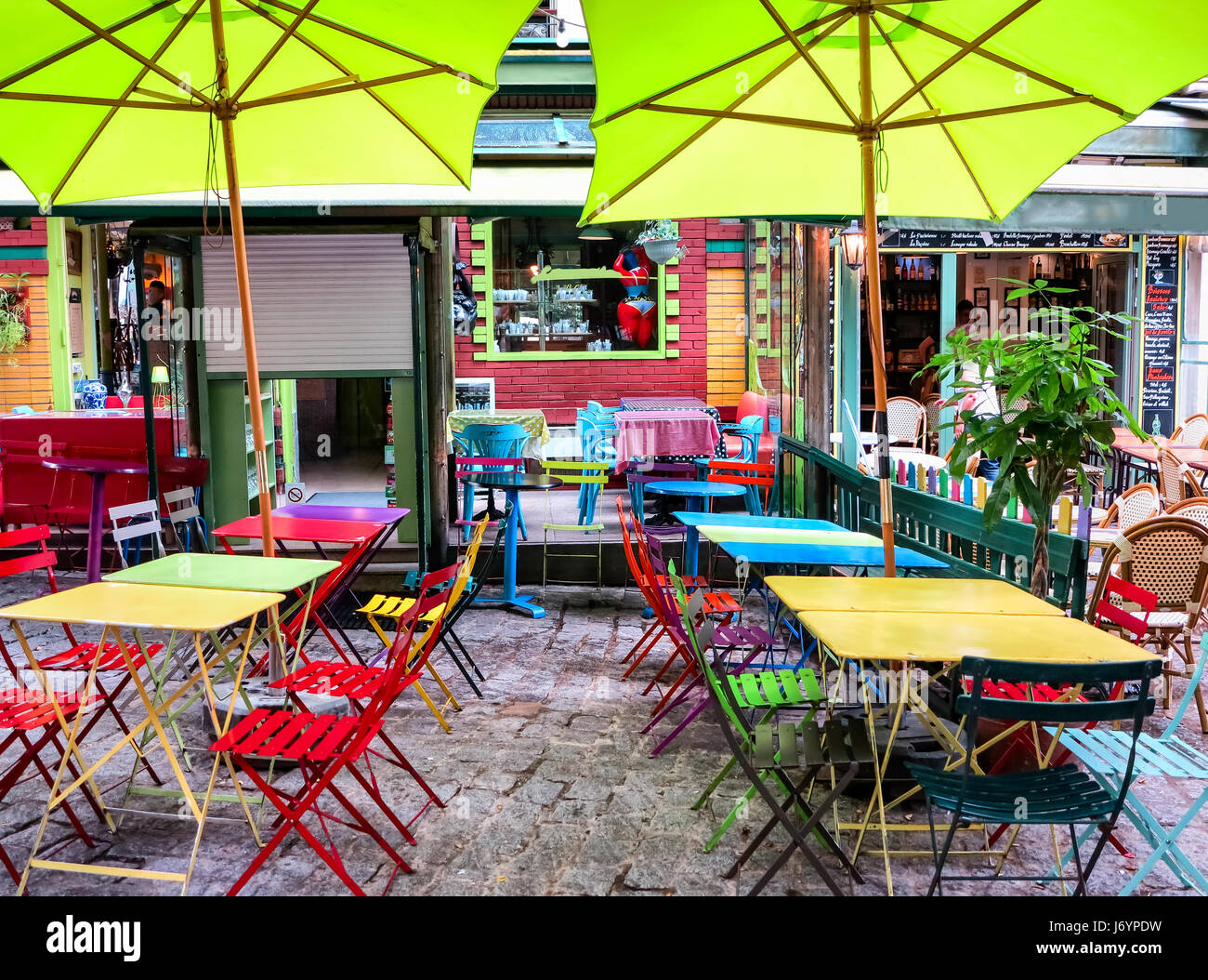Picturesque colorful cafe terrace close to the Pantheon-Sorbonne University in Paris, France - Stock Image