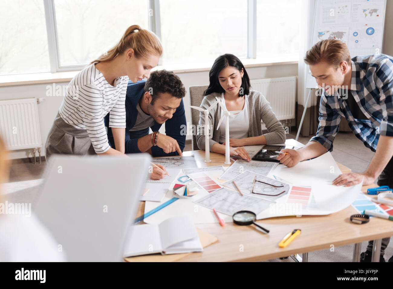 Nice serious engineers being involved in work - Stock Image