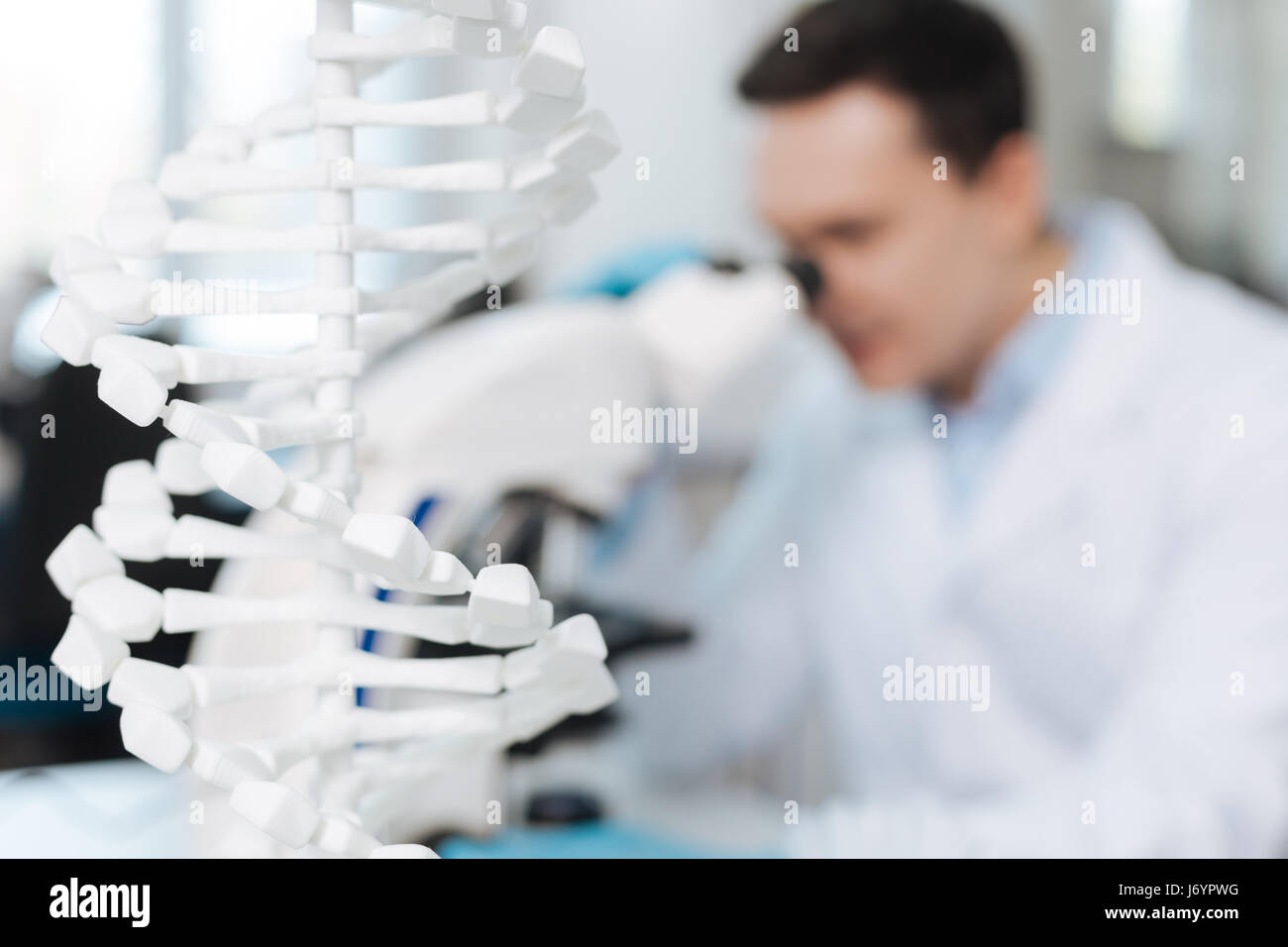 Close up of white model DNA helps in genetic researching - Stock Image