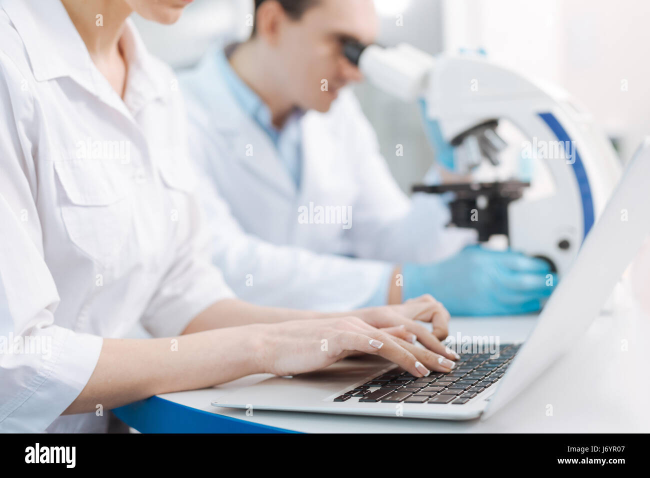 Confident practitioner working with computer - Stock Image