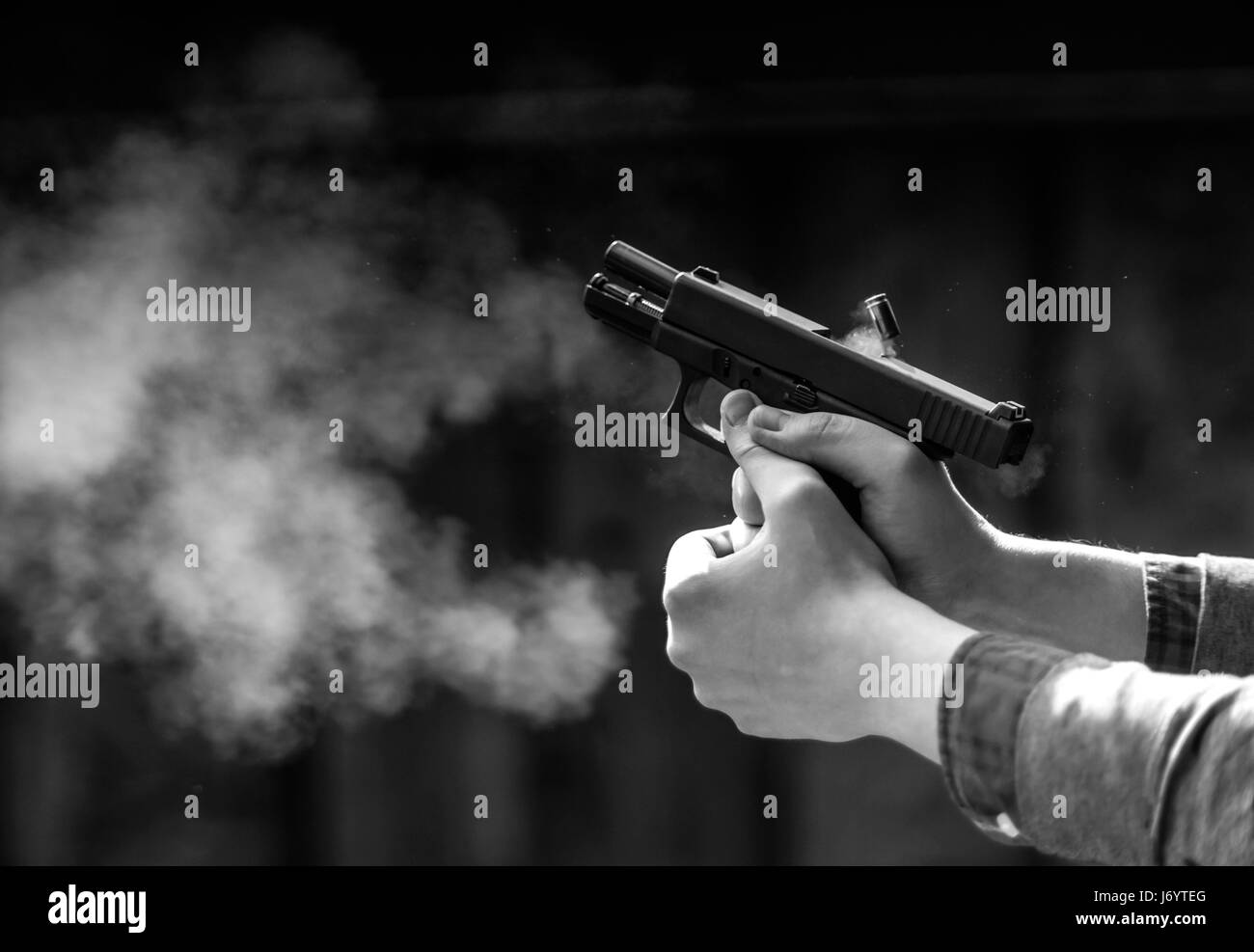 Pistol shot, weapon recoil, scaly - Stock Image