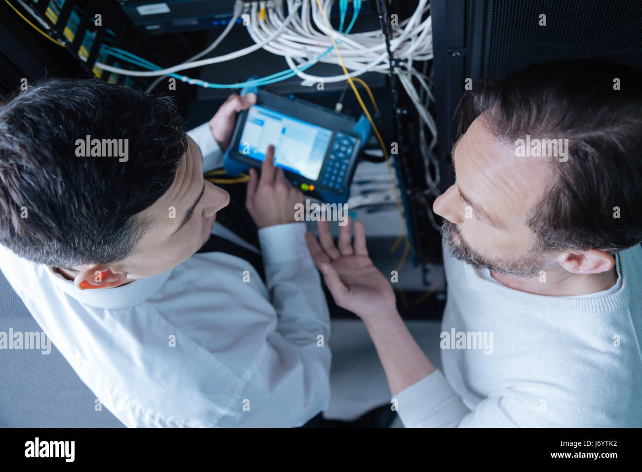 Top view of professional technicians having a conversation - Stock Image