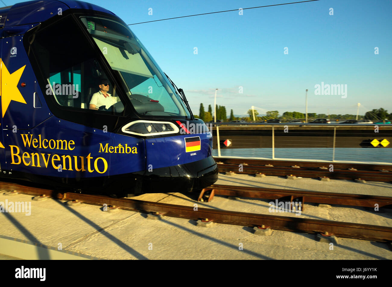 Blue electric tramway between Kehl in Germany  and Strasbourg in France - Stock Image