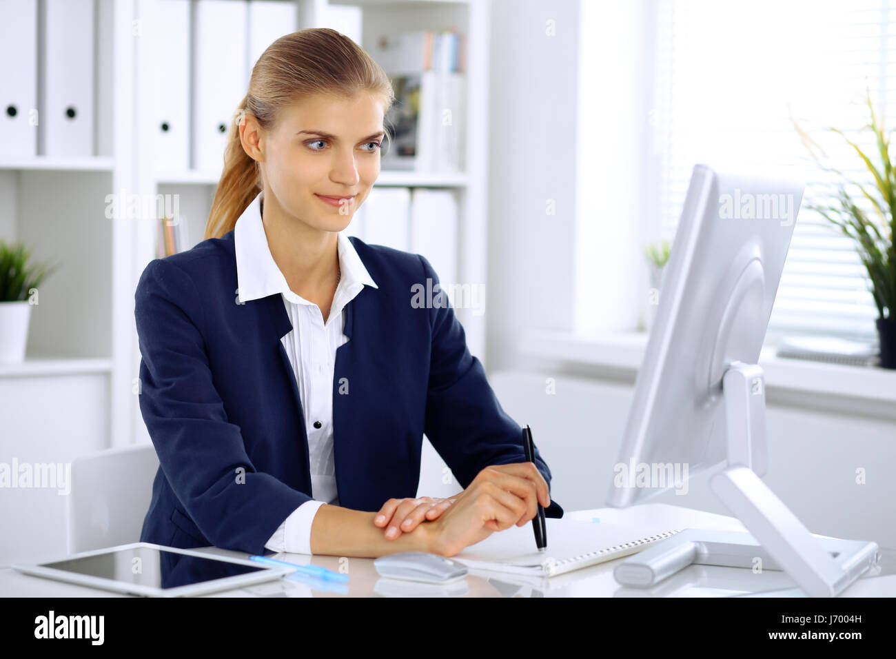 Modern business woman in the office - Stock Image
