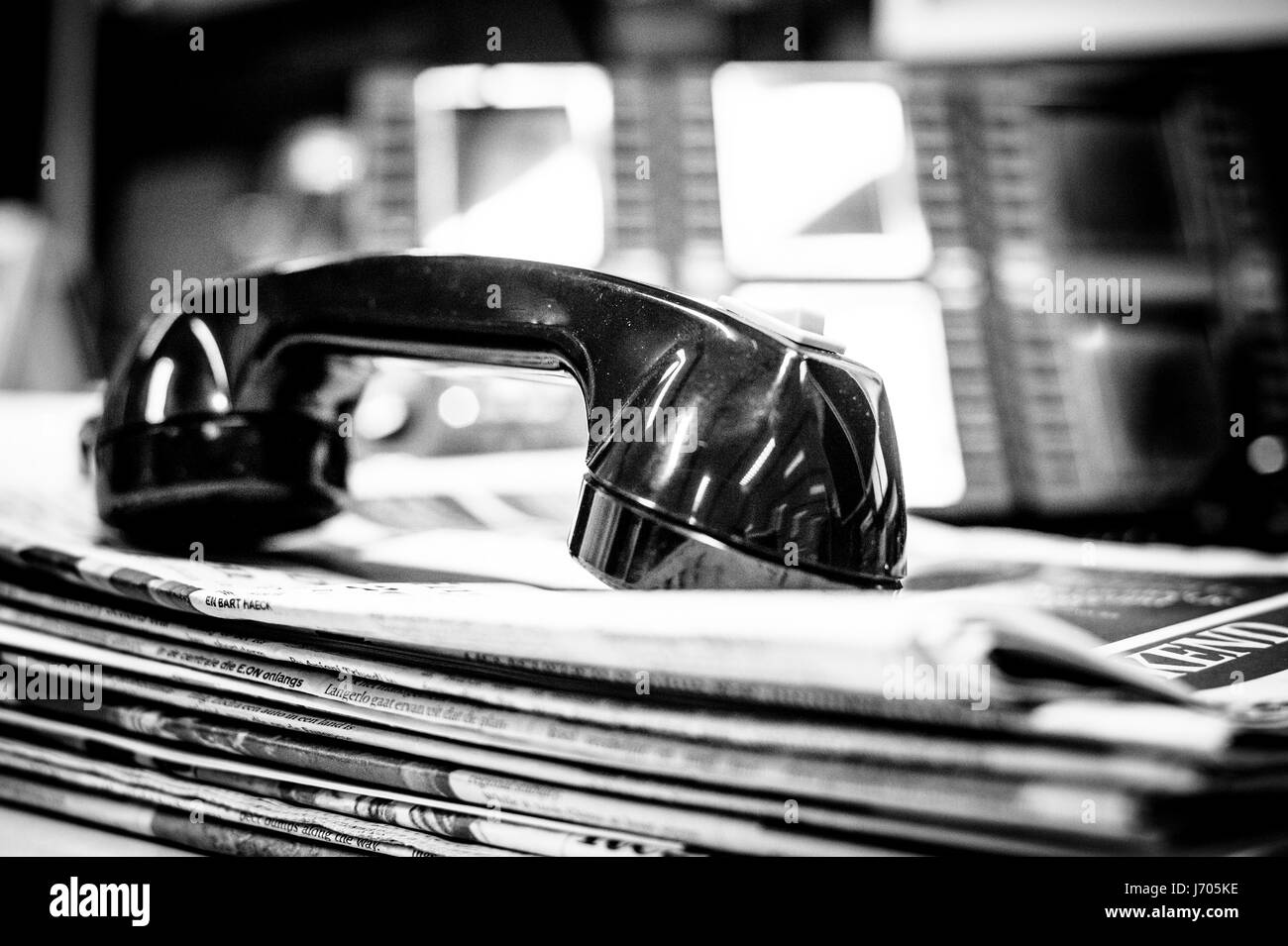 telephone horn on stack of papers - Stock Image