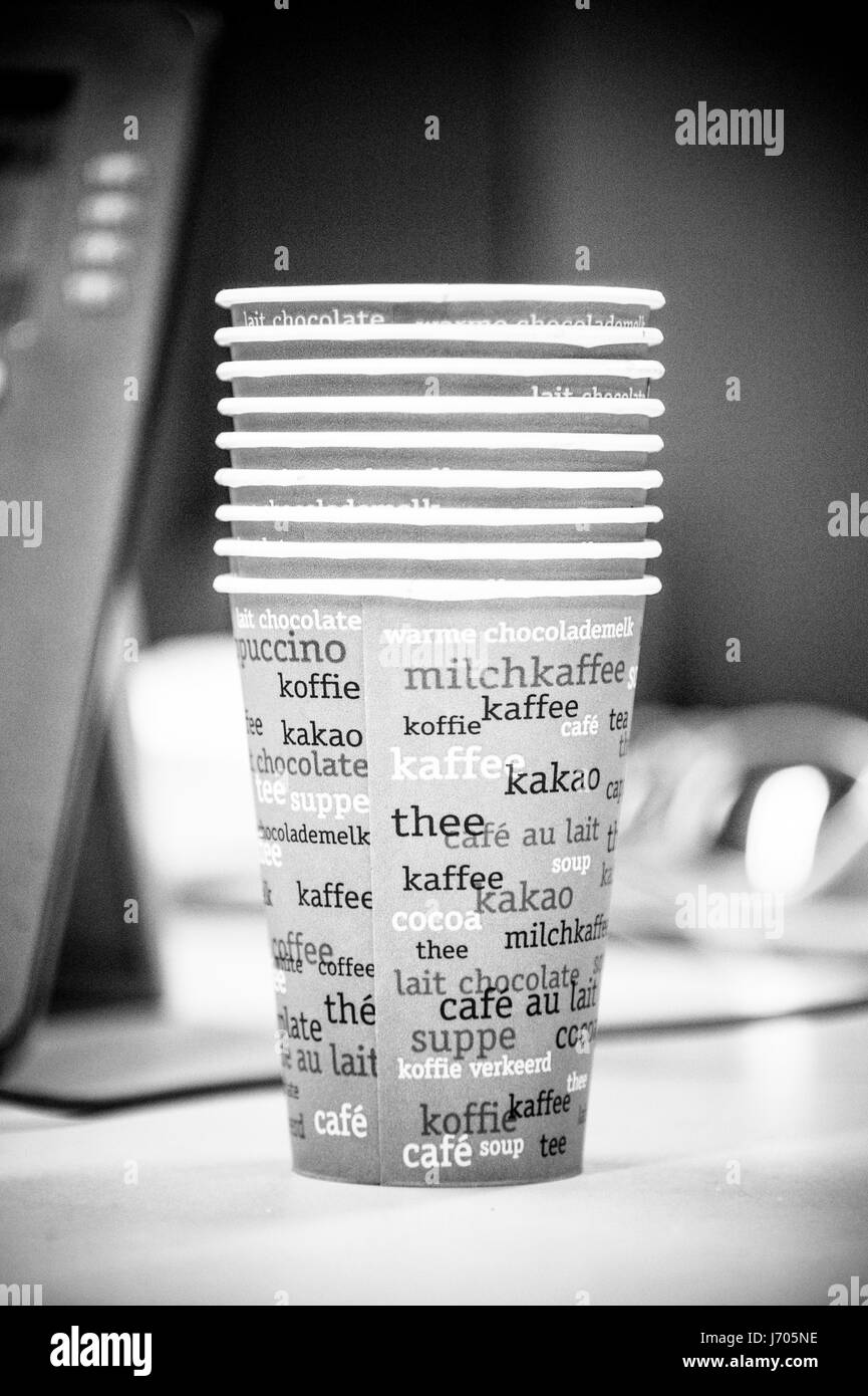 stack of cups on desk - Stock Image