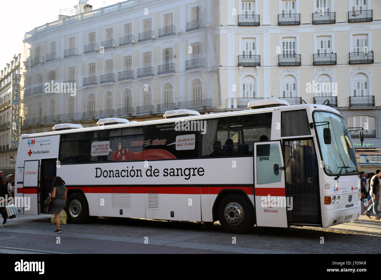 Blood donation bus, Plaza de la Puerta del Sol, Madrid, Spain - Stock Image