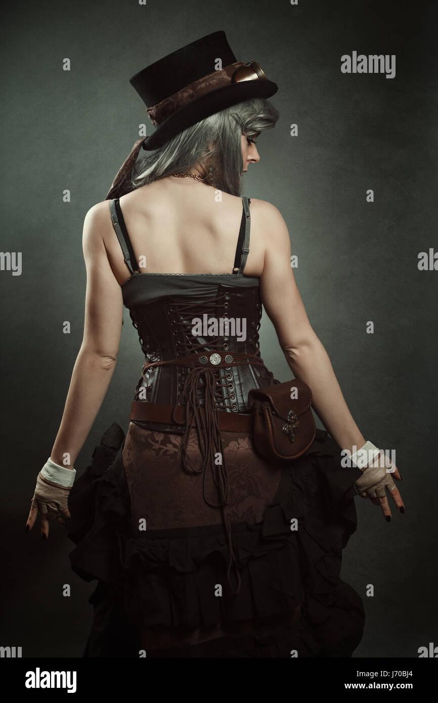 Woman back. Steampunk dress - Stock Image