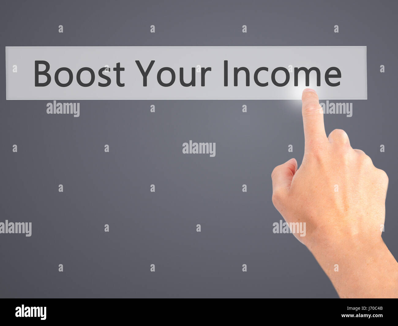 Boost Your Income - Hand pressing a button on blurred background concept . Business, technology, internet concept. - Stock Image