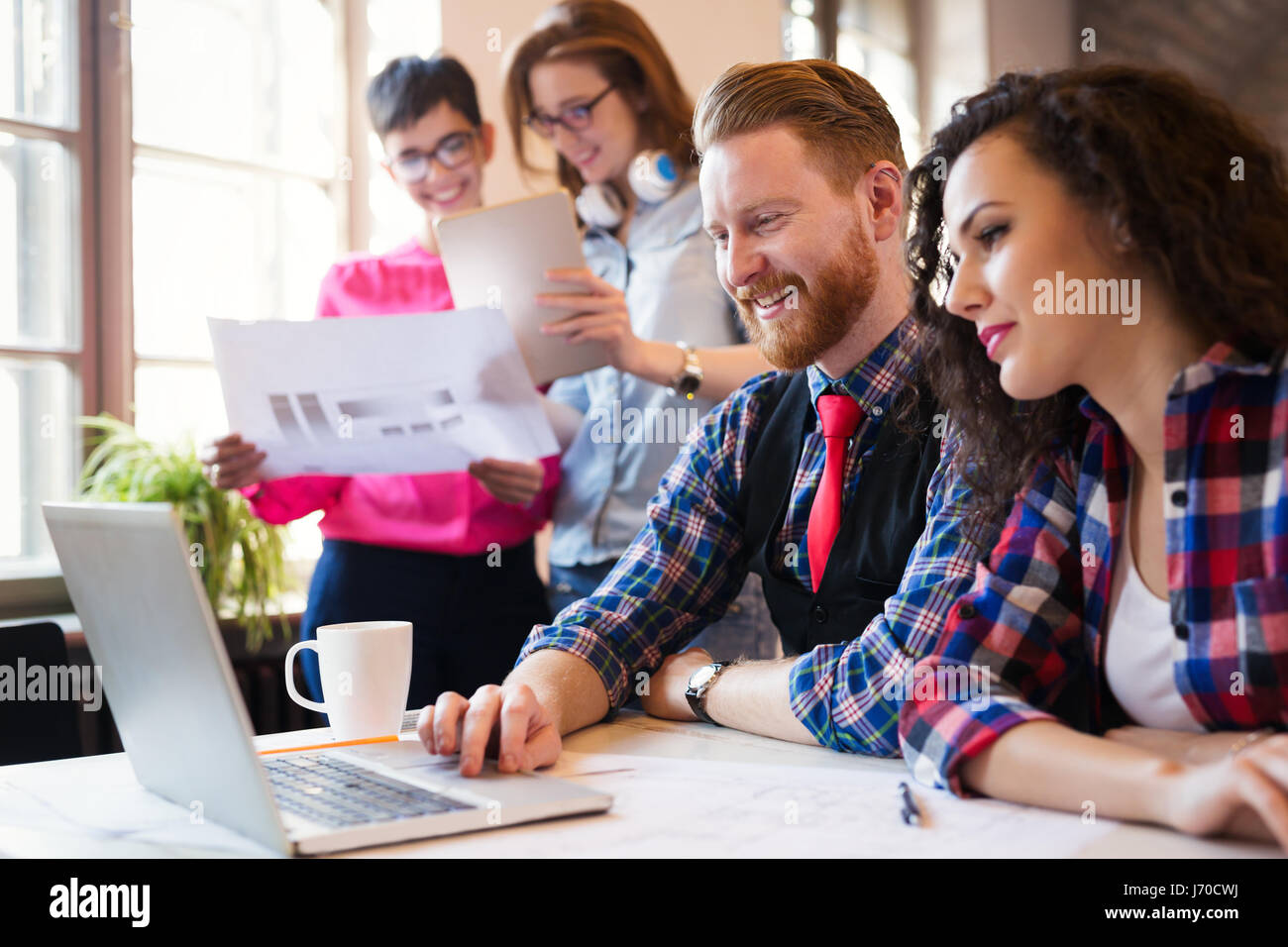 Business coworkers celebrate achieved goals in office Stock Photo