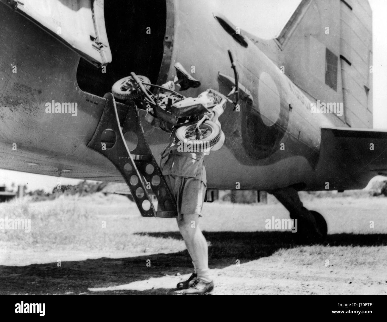 1944 Welbike being lifted on to military transporter plane - Stock Image