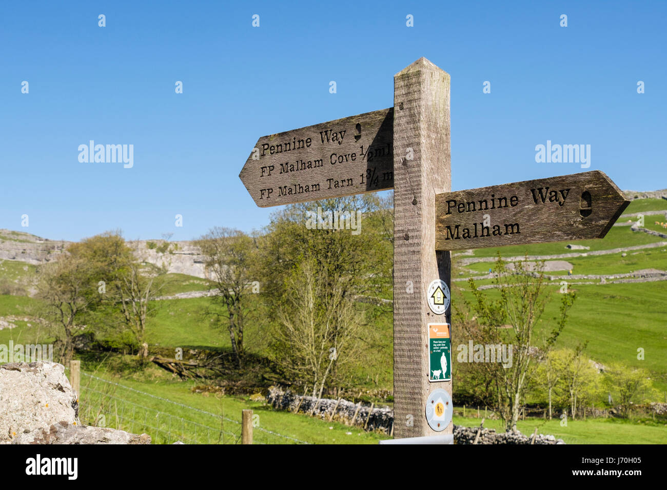 Pennine Way sign signpost on footpath to Malham Cove. Malham, Malhamdale, Yorkshire Dales National Park, North Yorkshire, - Stock Image