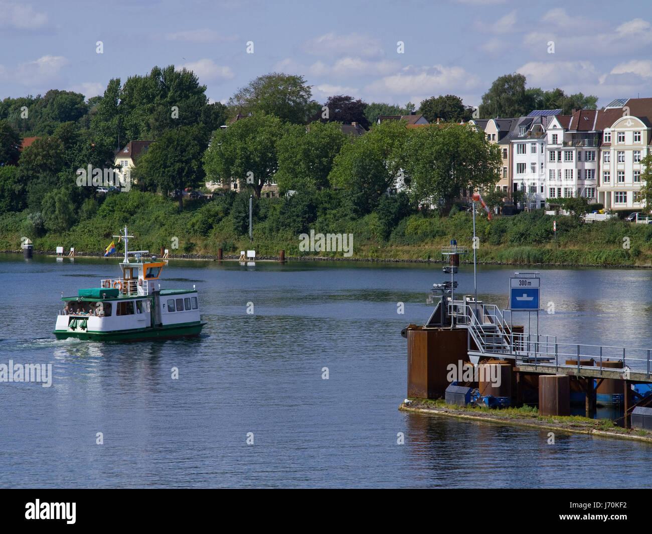 houses keel waterway ferry blue houses tree trees green keel waterway bluer Stock Photo