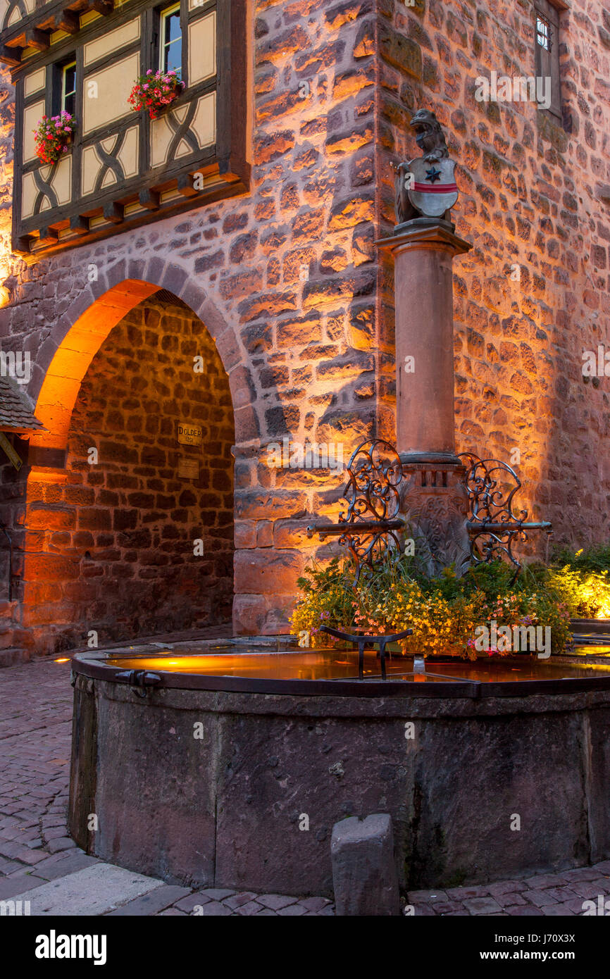 Evening at the medieval entry gate (La Porte Haute), Riquewihr, Alsace, Haut-Rhin, France Stock Photo