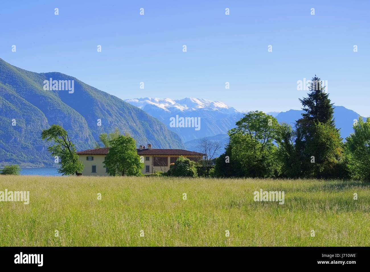 Iseo lake and small house, Lombardy in Italy - Stock Image