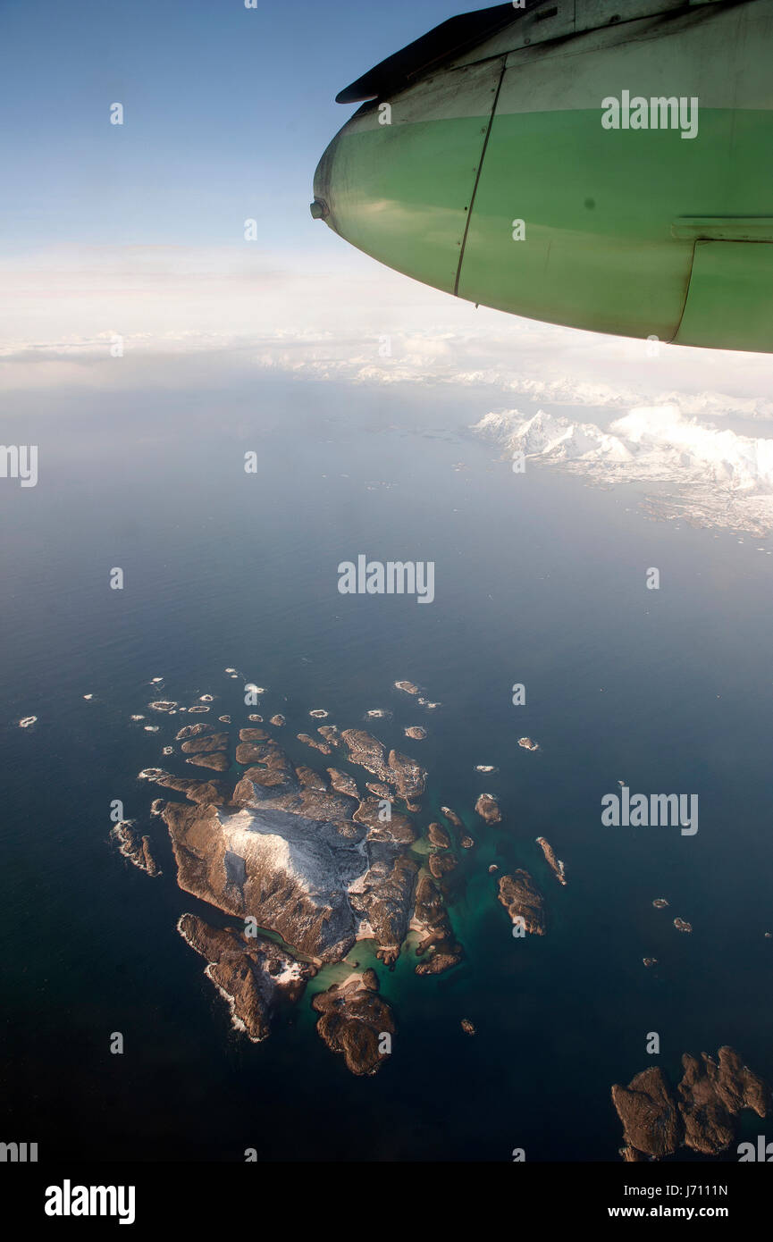 View from aircraft overflying rocky island - Stock Image