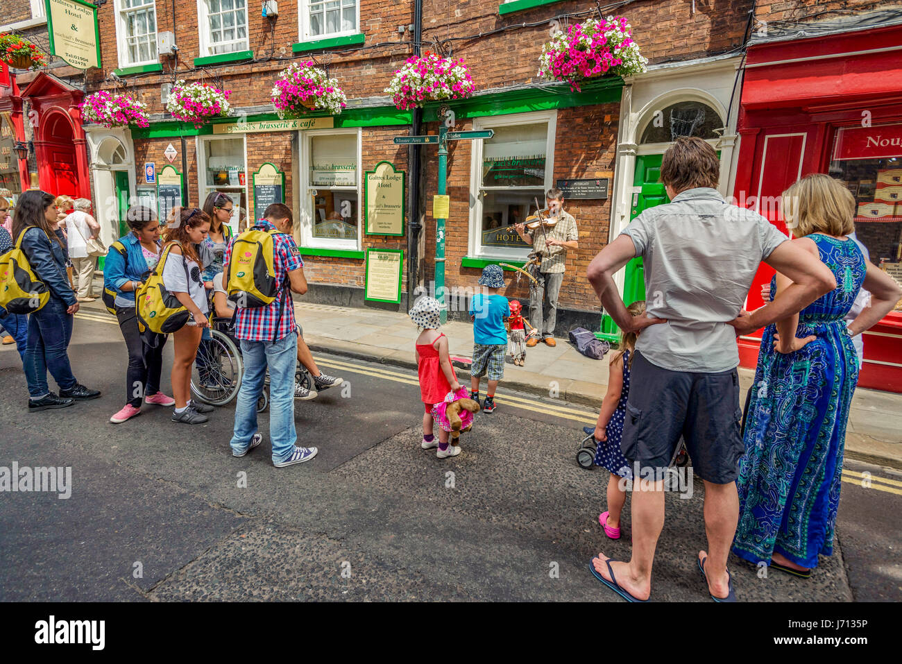 A street entertainer with puppet in the centre of York North Yorkshire. - Stock Image