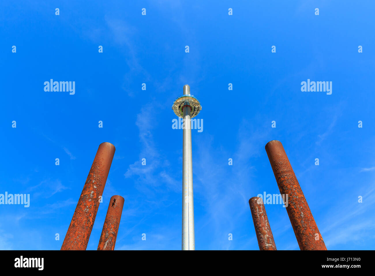 Brighton i360 observation tower on the seafront, with the rusty pier supports of the old West Pier in the foreground. Stock Photo