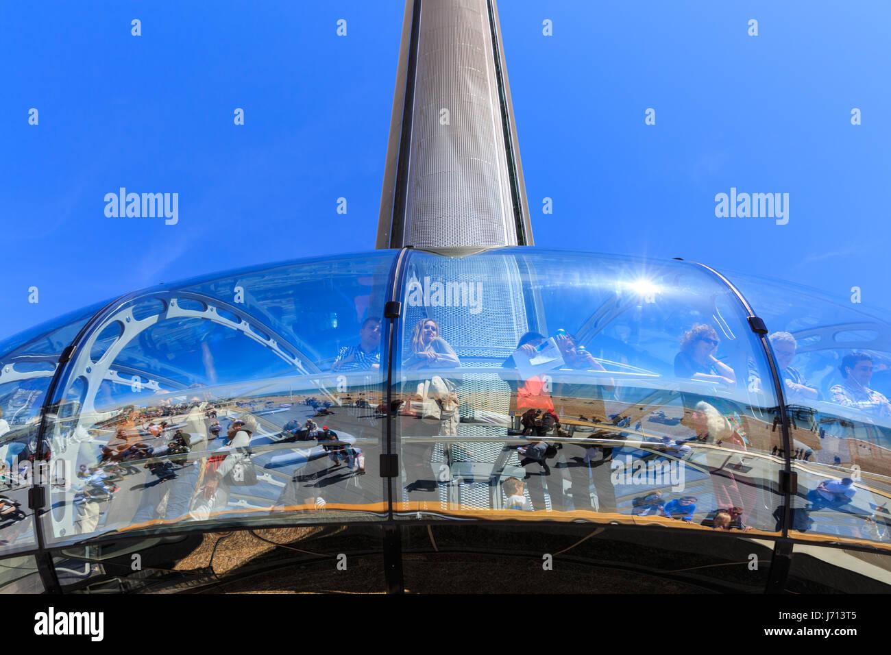 People enjoy the ride on the Brighton i360 (British Airways i360) observation tower, Brighton, UK - Stock Image