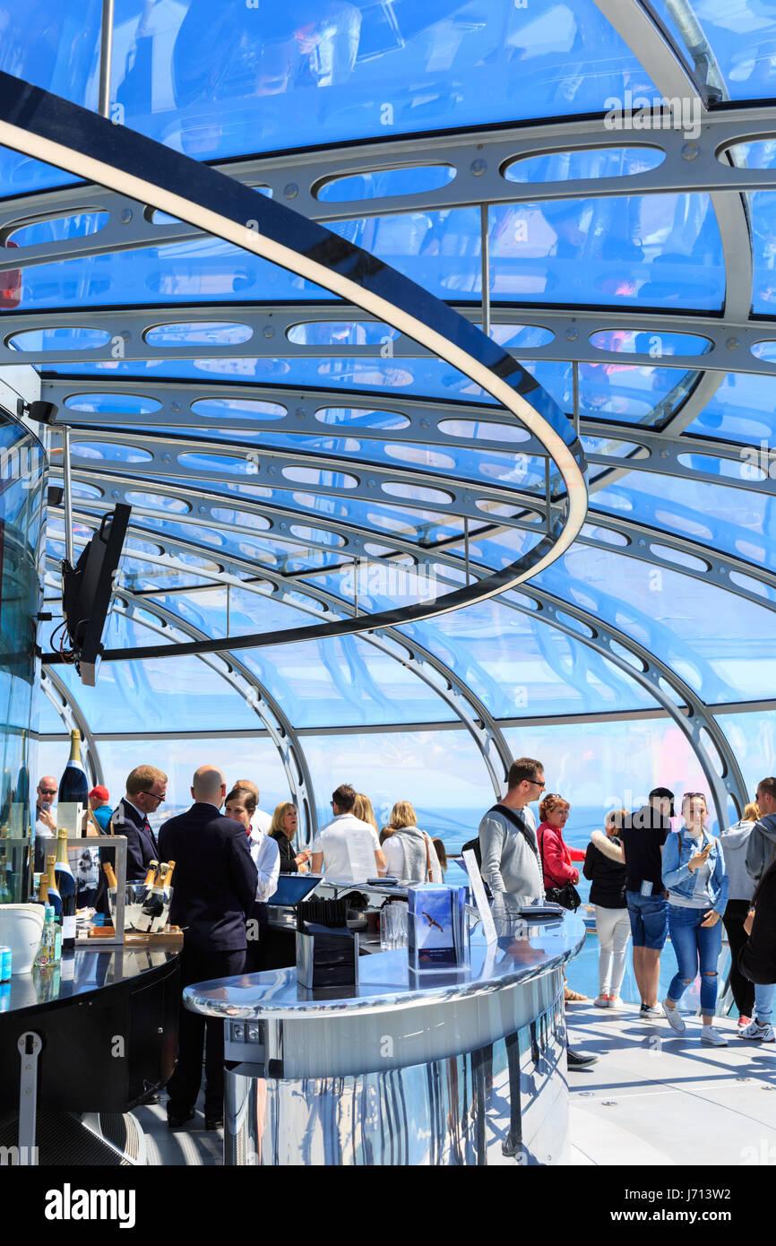 People enjoy the ride on the Brighton i360 observation tower, Brighton, UK - Stock Image