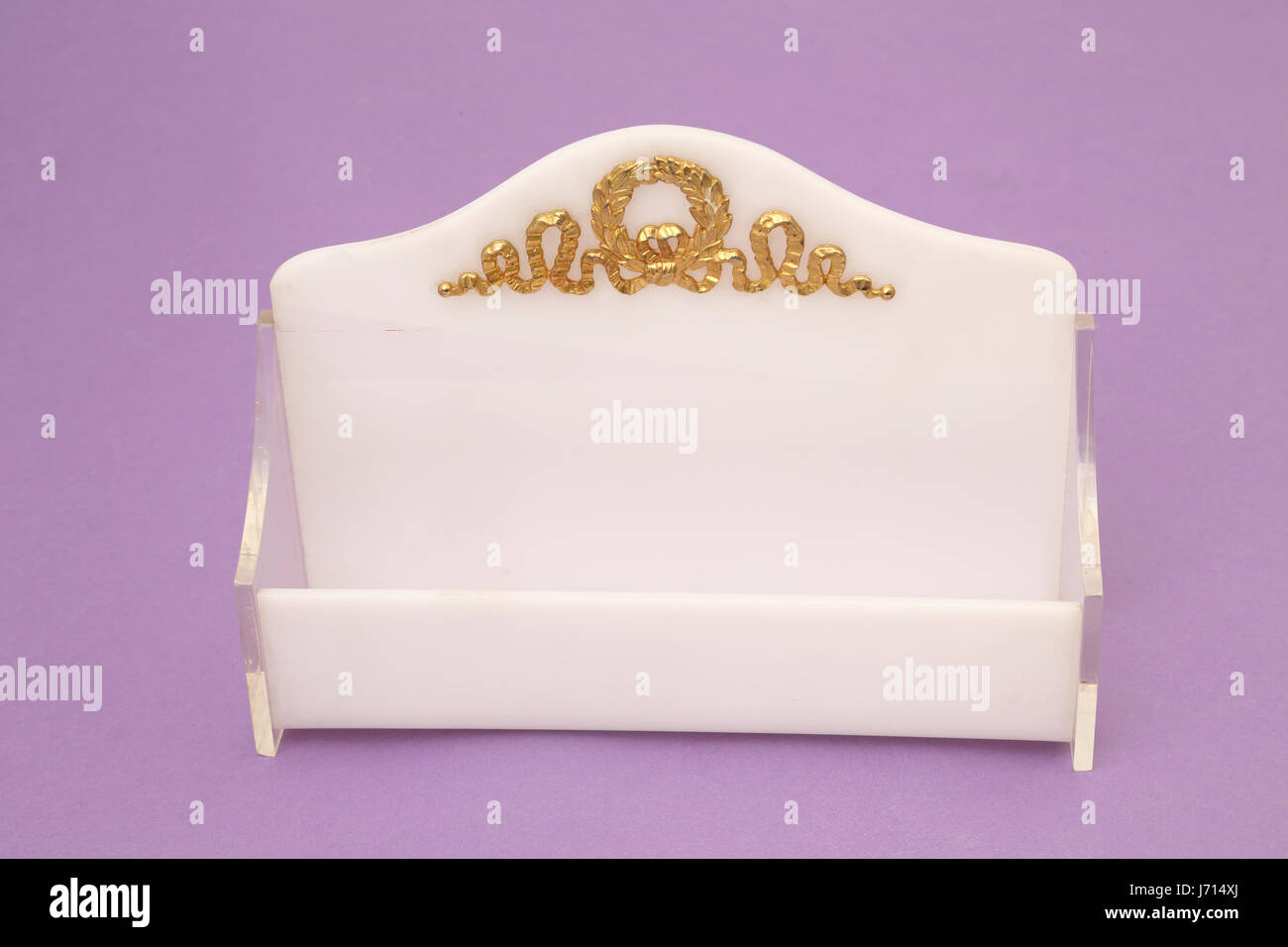 plastic letter holder with gold wreath design - Stock Image